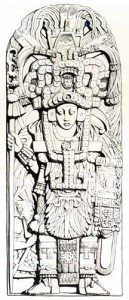 Fig.11 Stela A, Piedras Negras. The headdress worn by this personage represents the open jaws of a jaguar from which a small human head emerges. After Spinden 1957: fig. L.