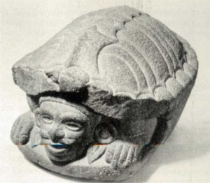 Fig.17 Stone figure representing the god Macuilxochitl, or 5 Flower, inside the mouth of a turtle. From Mixtequilla, Veracruz. National Museum of Anthropology, Mexico.